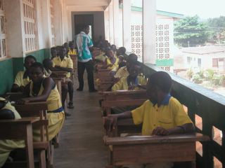 Students taking their exams in the corridor